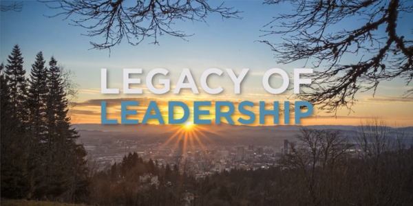 "The sun rising over Mt. Hood, with text overlayed saying ""Legacy of Leadership"""