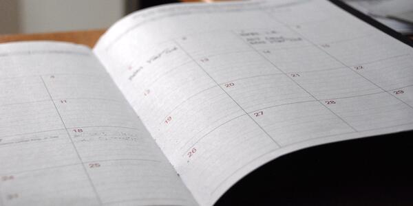 A calendar/planner opened on a desk