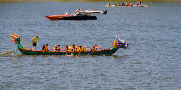 People on a dragon boat in the river