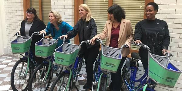 Commissioner Eudaly posing with other female transportation leaders for BIKETOWN's unveiling of the Women's History Month wrap