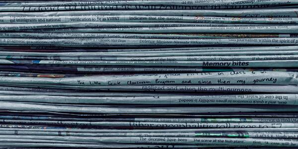 Stack of folded newspapers viewed from the edge