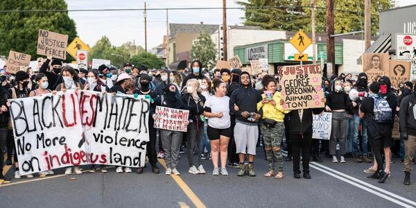 A photo by Mathieu Lewis Rolland Photography of dozens of Portlanders protesting for Black lives