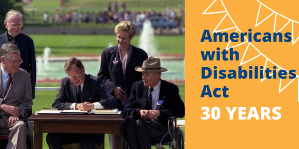 Photo shows signing of the Americans with Disabilities Act in 1990