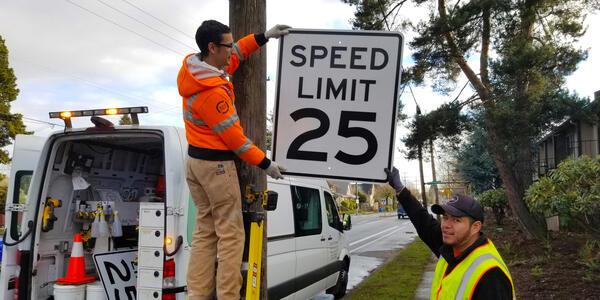 Updating speed limit signs on a Portland street.