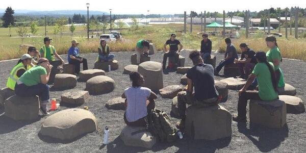 A photo of a youth group in Cully Park's Native Gathering Garden, being led by Portland Parks staff.