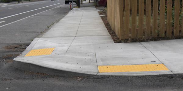 Curb ramps at sidewalk crossing