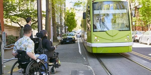 individuals in mobility devices waiting for the streetcar