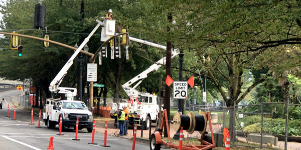 Crews work on traffic signals at the intersection of SW Naito Parkway and SW Columbia Street as part of the SW Naito Improvement Project. These updates will make it easier to manage traffic flow during construction. Photo by PBOT.