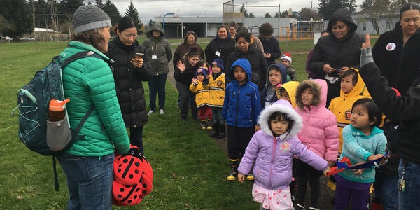 A group of children get ready to start a Ladybug nature walk at a park in east Portland.