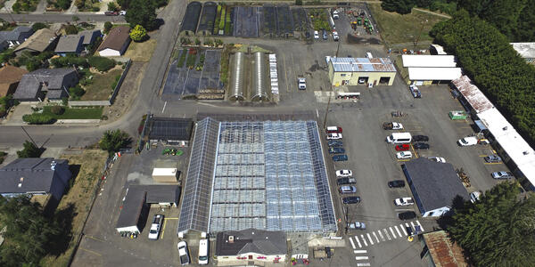 Image shows the greenhouse and other warehouse buildings located in the Mt. Tabor Maintenance Yard.