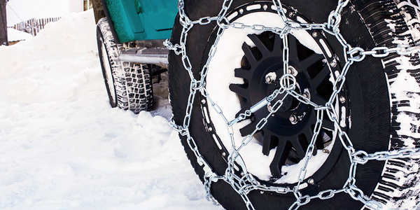 chains on car tire in the snow