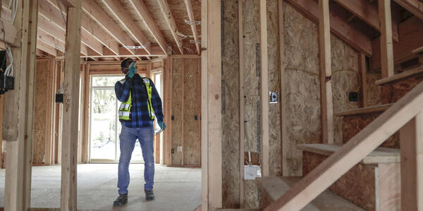 An inspector from the Bureau of Development Services inspects a new home under construction.