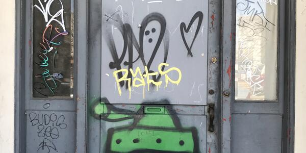 Unauthorized graffiti on a storefront door