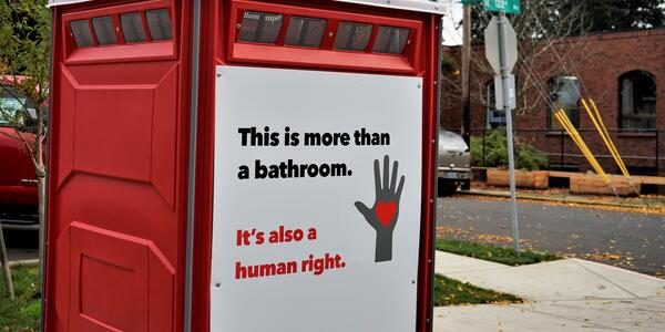 "Signs on Portland public toilets: ""This is more than a bathroom. It's also a human right."""