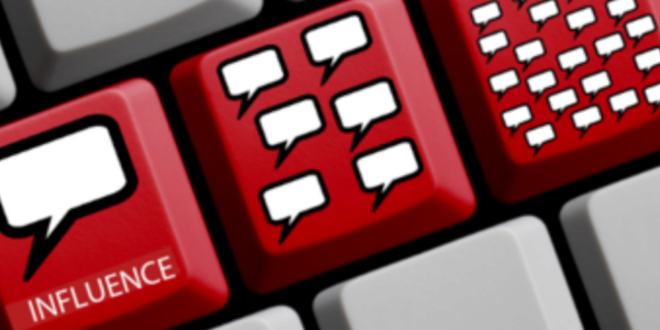 Photograph of a keyboard with modified keys. Keys have images of empty speech balloons.