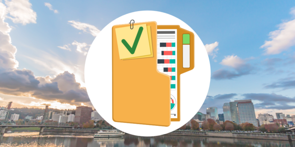 Icon of an audit file folder with assorted documents over a photograph of downtown Portland, Oregon and the waterfront looking from the east side of the Willamette River.