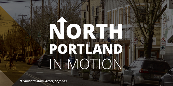 This image is styled to represent the North Portland in Motion Plan. It is a darkened image of N Lombard Street in Saint Johns, with the words North Portland in Motion overlaid.