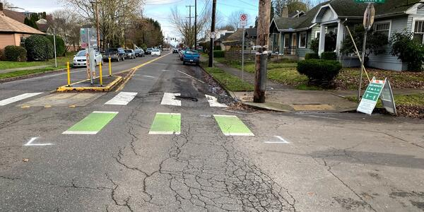 The failing road surface at the intersection of N Killingsworth Street and Concord Avenue. Photo by PBOT.