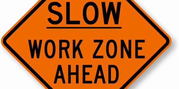 Construction sign reads SLOW WORK ZONE AHEAD