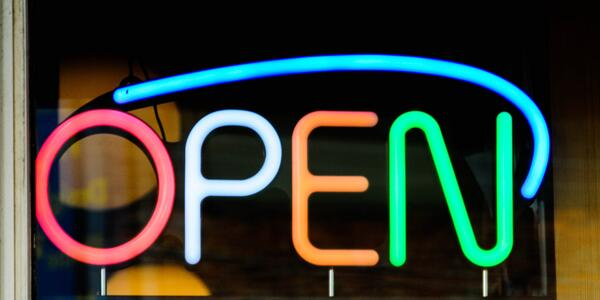 multicolor neon sign that says open.