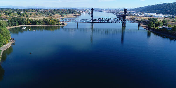 Aerial view of Willamette River near St. Johns. Photo shows the railroad bridge and area called Willamette Cove