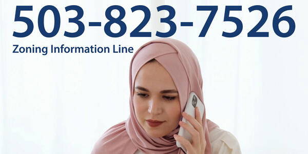 Zoning information line: 503-823-7526. A women is on the phone.