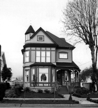 A black and white, dated image of a two-story house