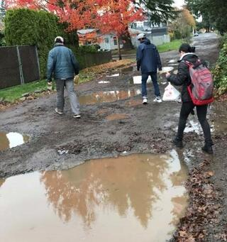 A student opts to walk through the mud as she trys to avoid a puddle on her way to school. Photo provided at SE 80th Avenue and Mill Street council presentation