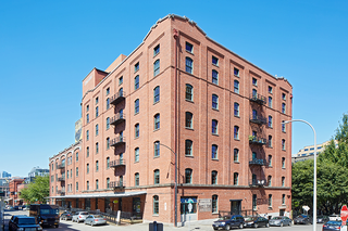 A seven story red brick building.