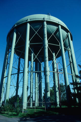 Tall green water tank