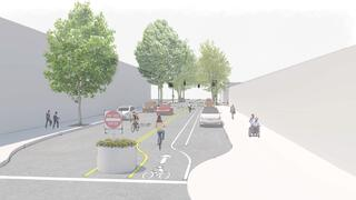 This rendering shows a one-way street with a bike lane that flows in the opposite direction. There is parking on both sides of the street, which points in the same direction as the flow of traffic.
