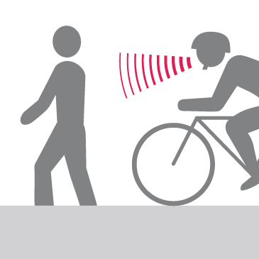 Bicyclist giving audible warning to pedestrian to let them know they are passing
