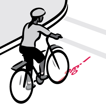 Bicyclist approaches bike street marking to request a green light