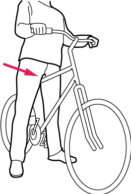Person standing on bike with arrow to correct height of bike bar