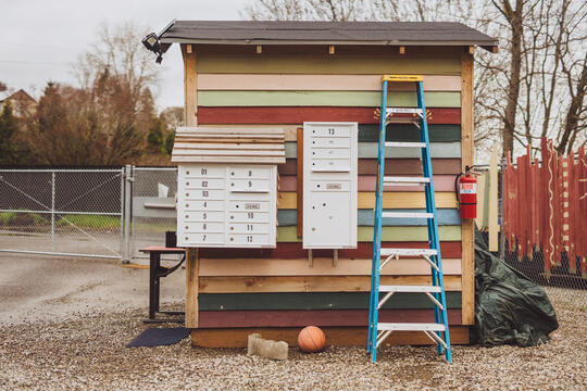 Small structure with multi-colored siding with group mailboxes attached