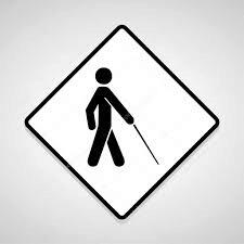 White diamond-shaped traffic sign shows person walking with a cane