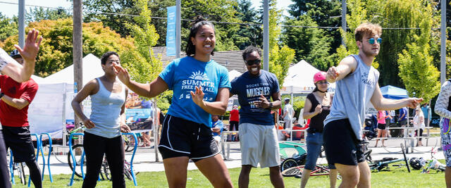 Sunday Parkways attendees participate in an outdoor fitness dance class