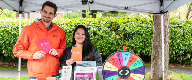 City staff share information and give out prizes at their Sunday Parkways booth