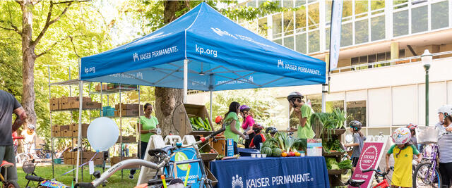Kaiser Permanente booth offers information to families at Sunday Parkways