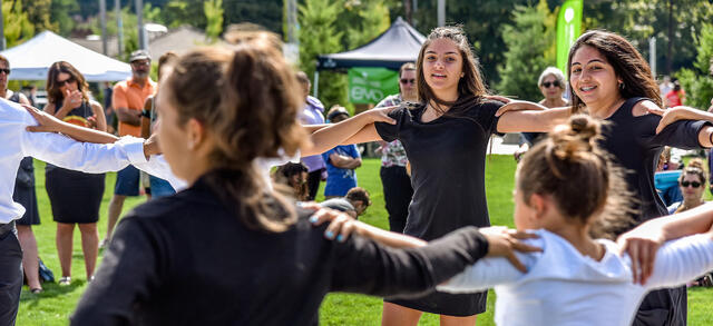 A photo of youth dancing at the Slavic Festival at Gateway Discovery Park.