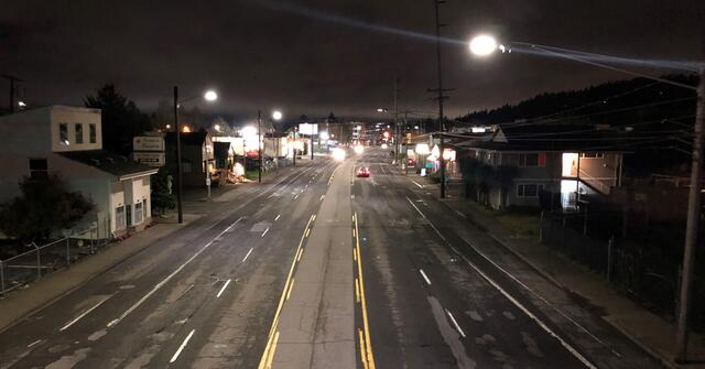 Lighting on both sides of wide streets, visible here on SE Division Street looking west of 85th Avenue, helps eliminate dark spots. Photo by PBOT.